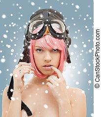pink hair girl in aviator helmet with snow
