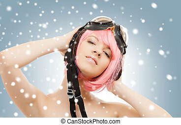 pink hair girl in aviator helmet with snow