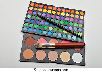 Picture of professional makeup colorful eyeshadow palettes with brushes. Beauty. Selective focus