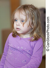 Picture of scared small girl with blue eyes and blond hair