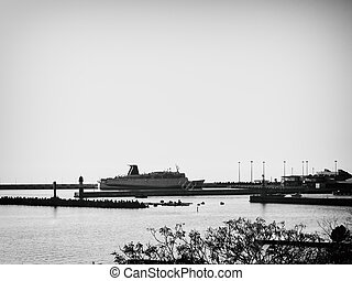 Picture of ship at seaport dock. Black-and-white
