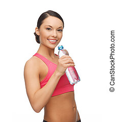 sporty woman drinking water from bottle - picture of sporty...