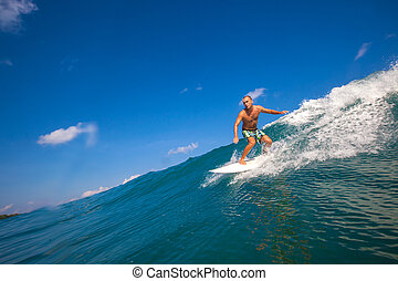 Surfing a Wave. GLand Surf Area. Indonesia.