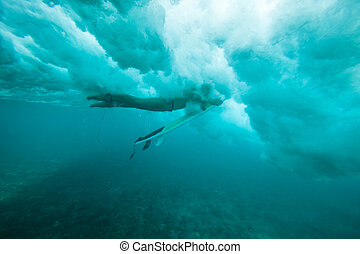 Surfing a Wave. Under Water Picture.