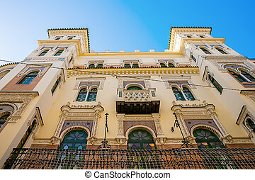facade of an old, traditional building in Seville, Spain