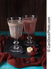 Picture of two glasses with smoothies on table