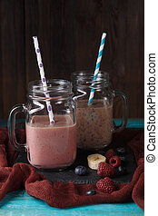 Picture of two jars with smoothies on table