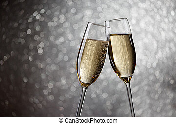 Picture of two wine glasses with champagne on gray...
