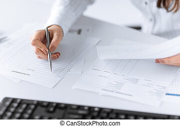 woman hand filling in blank paper or document - picture of...