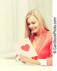 woman holding postcard with heart shape - picture of woman ...