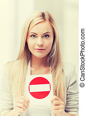 woman with no entry sign
