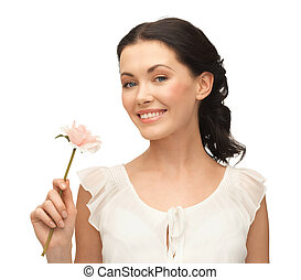 young and beautiful woman with flower - picture of young and...
