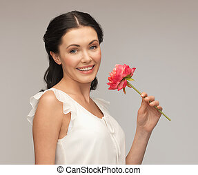 young and beautiful woman with flower
