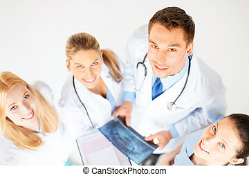 young group of doctors looking at x-ray