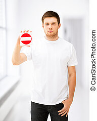 young man showing no entry sign - picture of young man...