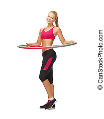 young sporty woman with hula hoop - picture of young sporty...