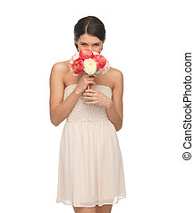 woman smelling bouquet of flowers - picture of young woman ...