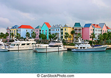 colourfully painted homes on a carbbean island