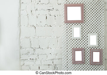 Picture photo frames on a white brick wall