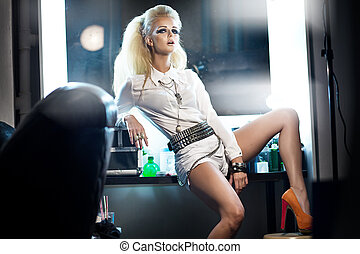 Picture presenting stylish blonde woman in studio