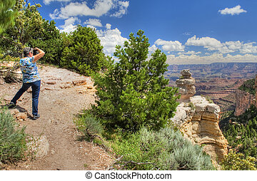 Picture taking at Grand Canyon - Woman Taking Picture of the...