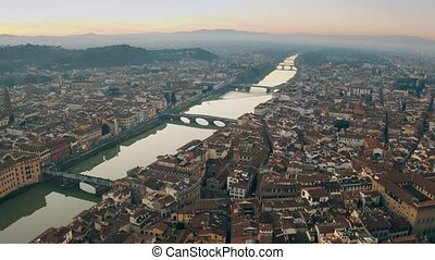 Picturesque aerial shot of bridges over the Arno river in...