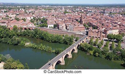 Panoramic view from drone of houses and bridges over Tarn river of french city Montauban