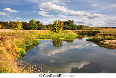 Picturesque autumn landscape of river with bright trees and ...