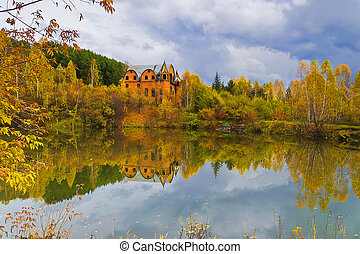 Picturesque autumn landscape on the lake