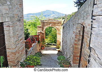 picturesque back alley in an old italian village