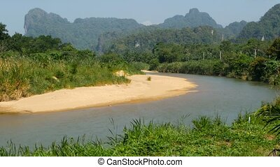 Picturesque bank of the river on a background of karst mountains