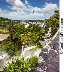 Picturesque basaltic ledges form the famous waterfalls. ...