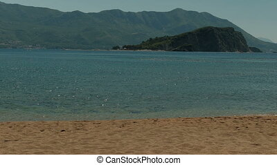 Picturesque bay and deserted beach on sunny day. Secluded...