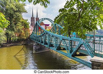 Picturesque bridge to the Tumsky island