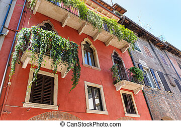 Picturesque facede, shutters and alleys in northern italy, ...