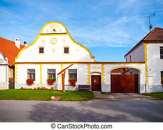Picturesque house of Holasovice, small rural village with rustic baroque architecture. Southern Bohemia, Czech Republic. UNESCO heritage site