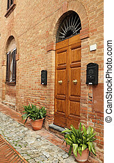 picturesque italian doorway in tuscan borgo Certaldo Alto