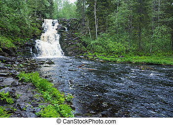 Picturesque landscape with a waterfall in the forest of Karelia