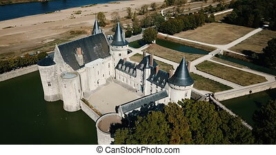 Picturesque autumn landscape with imposing medieval fortress of Chateau de Sully-sur-Loire, France