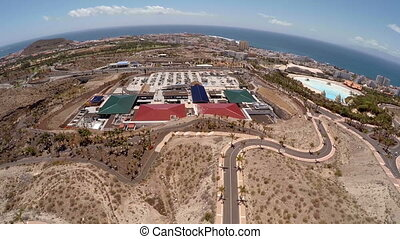 Picturesque mountain landscape of Tenerife. Aerial photography. Quadrocopter flies over the greenhouses and motorway Tenerife