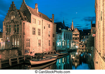 Picturesque night canal Dijver in Bruges - Scenic cityscape...