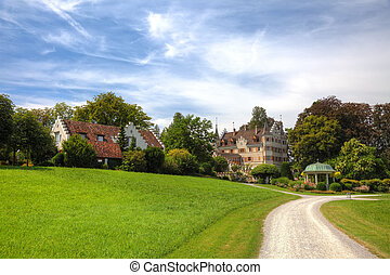 Picturesque old buildings in swiss park, Europe.