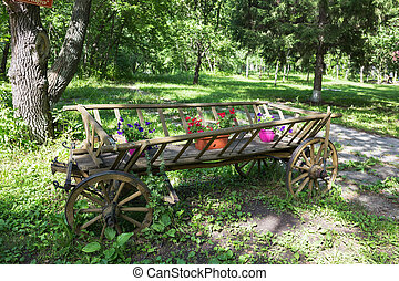 Picturesque old wooden cart with flowers