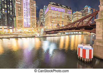 Picturesque riverside Chicago skylines at blue hour along LaSalle Street