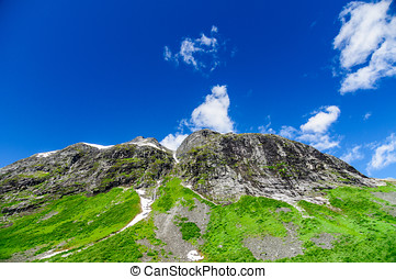 Picturesque rocks against blue sky, norwegian summer landscape