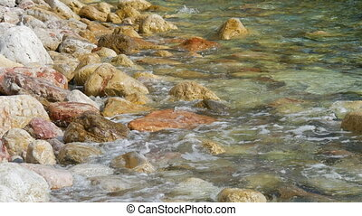 Picturesque rocks cost against the background of the clear turquoise sea in the Bay of Kotor, Montenegro. Beautiful virgin nature.