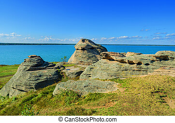 Picturesque rocks on the lake shore