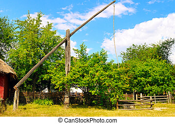 picturesque rural landscape with a well a crane
