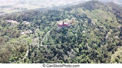 Picturesque Sintra Mountains landscape in sunny spring day with Romanticist castle of Pena Palace, Portugal