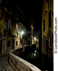 Picturesque small canal in Venice,Italy,by night.